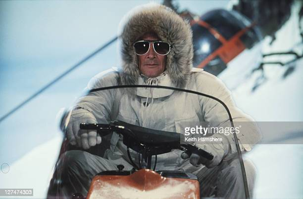 A matte shot of English actor Roger Moore as 007 driving a snowmobile in a publicity still for the James Bond film 'A View To A Kill' 1984 The...