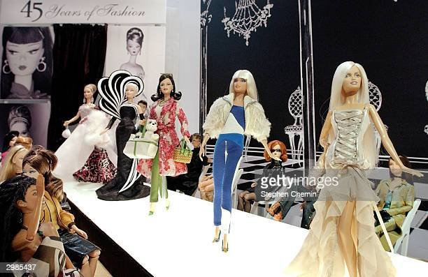 Mattel celebrates 45 years of fashion with a runway display featuring Barbies with clothes by famous designers such as Versace Kate Spade and Bob...
