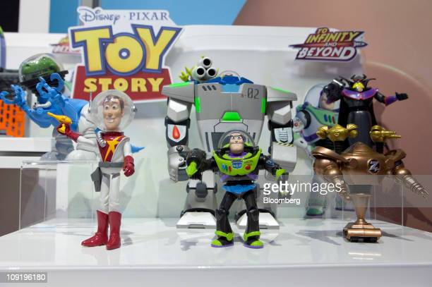 Mattel Inc action figures from the Walt Disney Co Pixar Toy Story movies sit on display during the Toy Industry Association 108th American...