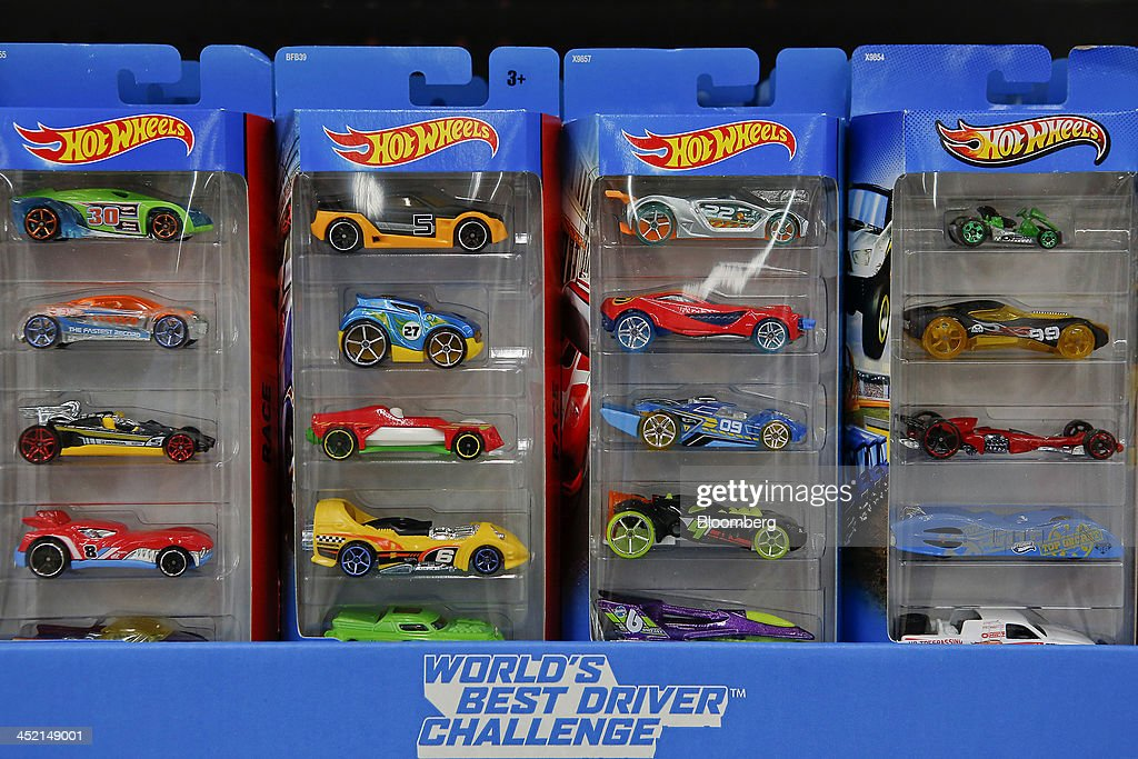 Mattel Inc. Hot Wheels cars are displayed for sale at a Wal-Mart Stores Inc. location ahead of Black Friday in Los Angeles, California, U.S., on Tuesday, Nov. 26, 2013. Wal-Mart Stores Inc. said Doug McMillon, head of its international business, will replace Mike Duke as chief executive officer when he retires as the world's largest retailer struggles to ignite growth at home and abroad. Photographer: Patrick T. Fallon/Bloomberg via Getty Images
