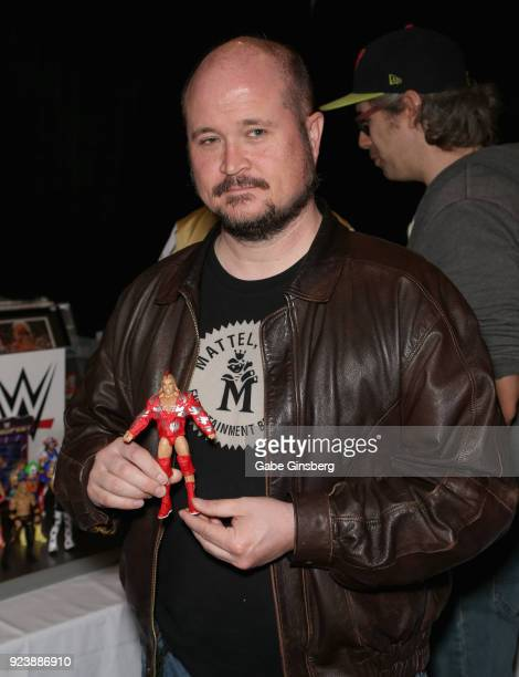 Mattel Wwe Designer Bill Miekina Holds Up A Red Rooster Elite Action Figure During Vegas Toy