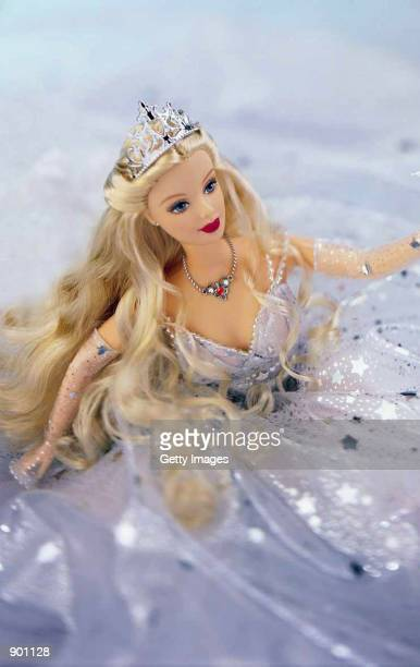 Mattel's 2001 Holiday Celebration Barbie doll is on display in an undated photo The doll's clothing is advertised as a commemoration of the year...