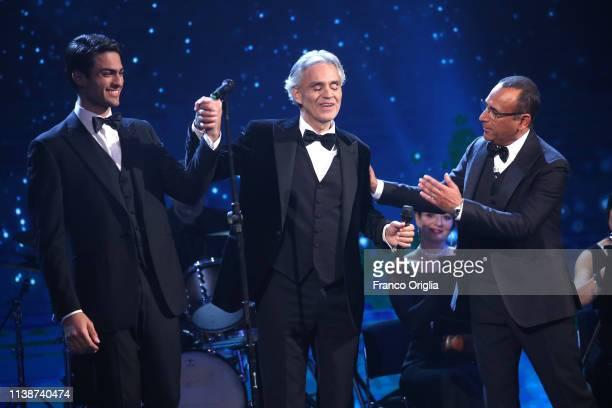 Matteo and Andrea Bocelli and Carlo Conti on the stage during the 64. David Di Donatello Award Ceremony on March 27, 2019 in Rome, Italy.