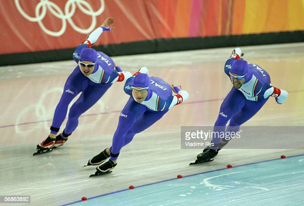 Matteo Anesi Enrico Fabris and Ippolito Sanfratello of Italy skate on their way to defeating Canada with a time of 34446 to win the gold medal in the...