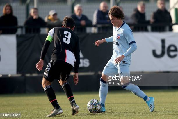 Matteo Anzolin of Juventus Turin U19 and Rodrigo Riquelme of Atletico Madrid U19 battle for the ball during the UEFA Youth League match between...