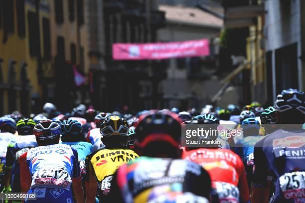 Matteo Badilatti of Switzerland and Team Groupama - FDJ & The peloton passing through Abbiategrasso City at start during the 104th Giro d'Italia...