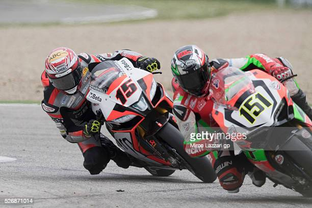Matteo Baiocco of Italy and VFT Racing leads Alex De Angelis of Rep San Marino and IodaRacing Team during the Superbike race 2 during the World...