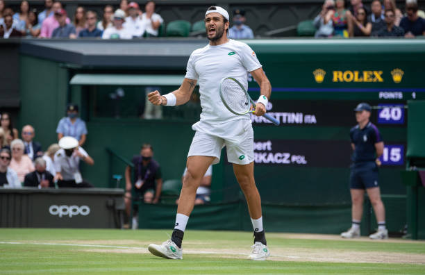 Matteo Berrettini of Italy celebrates victory after winning his Men's Singles Semi-Final match against Hubert Hurkacz of Poland during Day Eleven of...