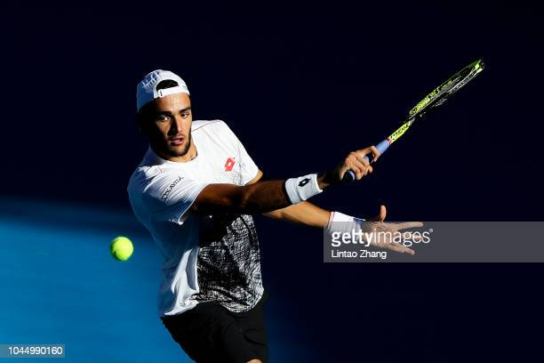 Matteo Berrettini of Italy hits a return against Kyle Edmund of Great Britain during their Men's Singles 2nd Round match of the 2018 China Open at...