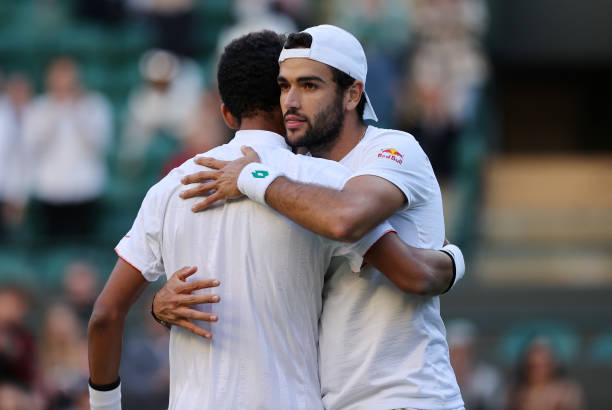 Matteo Berrettini of Italy interacts with Felix Auger Aliassime of Canada after winning their men's Singles Quarter Final match on Day Nine of The...