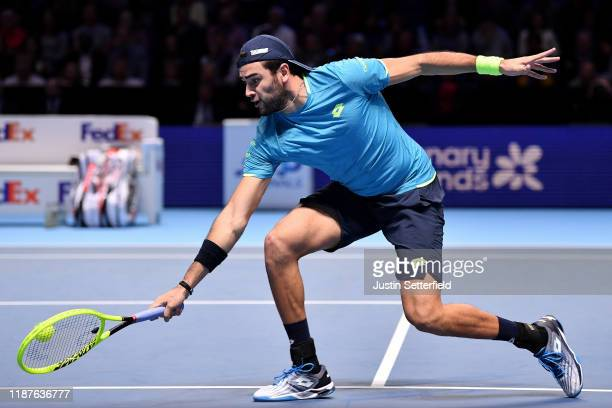 Matteo Berrettini of Italy plays a backhand in his singles match against Dominic Thiem of Austria during Day Five of the Nitto ATP Finals at The O2...
