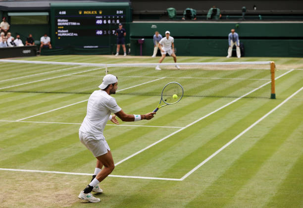 Matteo Berrettini of Italy plays a forehand in his Men's Singles Semi-Final match against Hubert Hurkacz of Poland during Day Eleven of The...