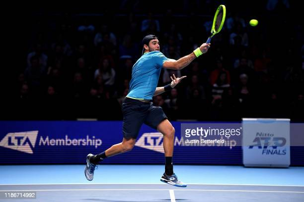 Matteo Berrettini of Italy plays a forehand in his singles match against Novak Djokovic of Serbia during Day One of the Nitto ATP Finals at The O2...