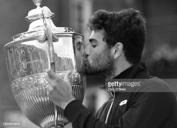 Matteo Berrettini of Italy poses with the trophy after winning the The cinch Championships during Day 7 of The cinch Championships at The Queen's...