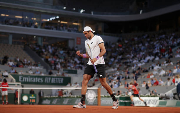 Matteo Berrettini of Italy reacts during his Mens Singles Quarter-Final match against Novak Djokovic of Serbia during Day Eleven of the 2021 French...