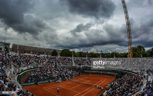 Matteo Berrettini of Italy returns the ball to Dominic Thiem of Austria during the third round at Roland Garros Grand Slam Tournament Day 6 on June...