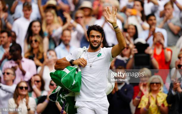 Matteo Berrettini of Italy waves to the crowd as he walks off the court after winning his Men's Singles Semi-Final match against Hubert Hurkacz of...