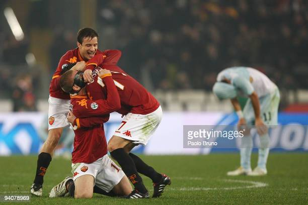 Matteo Brighi Daniele De Rossi and Marco Cassetti of AS Roma celebrate the victory after the Serie A match between Roma and Lazio at Stadio Olimpico...