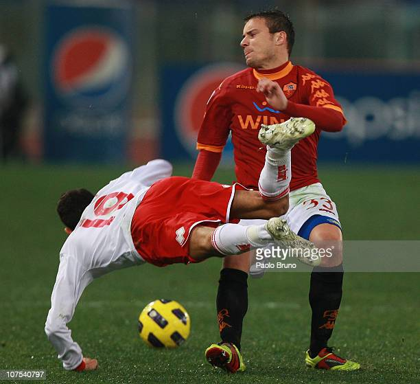 Matteo Brighi of AS Roma competes for the ball with Marco Crimi of AS Bari during the Serie A match between AS Roma and AS Bari at Stadio Olimpico on...