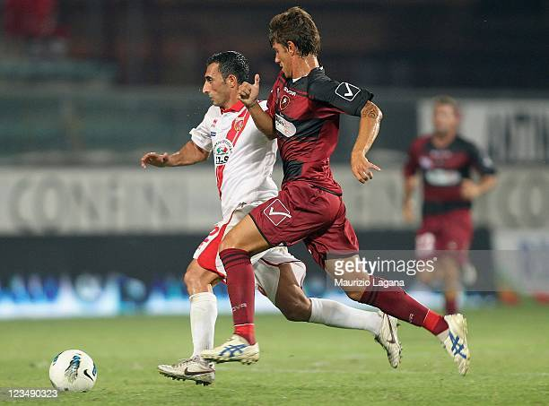 Matteo D'Alessandro of Reggina competes for the ball with Gaetano Caridi of Grosseto during the Serie B match between Reggina Calcio and US Grosseto...