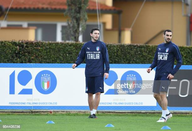 Matteo Darmian and Davide Zappacosta of Italy look on during a training session at Centro Tecnico Federale di Coverciano on March 19 2018 in Florence...