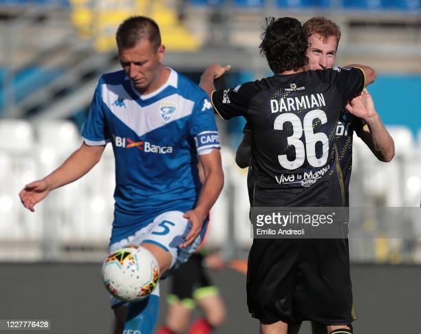 Matteo Darmian and Dejan Kulusevski of Parma Calcio celebrate their opening goal during the Serie A match between Brescia Calcio and Parma Calcio at...