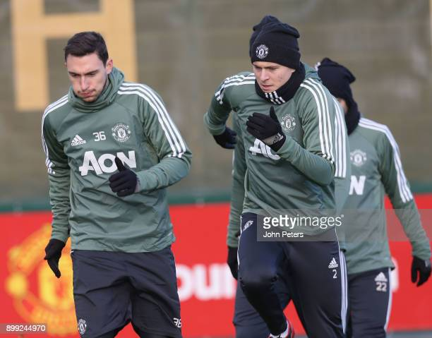 Matteo Darmian and Victor Lindelof of Manchester United in action during a first team training session at Aon Training Complex on December 28 2017 in...