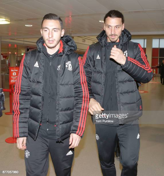 Matteo Darmian and Zlatan Ibrahimovic of Manchester United check in ahead of their flight to Basel at Manchester Airport on November 21 2017 in...