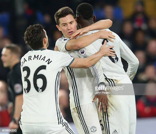 Matteo Darmian Ander Herrera and Paul Pogba of Manchester United celebrate Zlatan Ibrahimovic scoring their second goal during the Premier League...