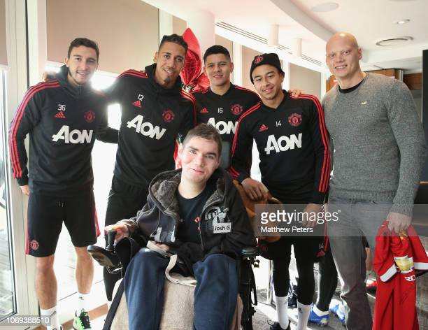 Matteo Darmian Chris Smalling Marcos Rojo and Jesse Lingard of Manchester United pose with Josh during the MU Foundation's Dream Day for fans with...