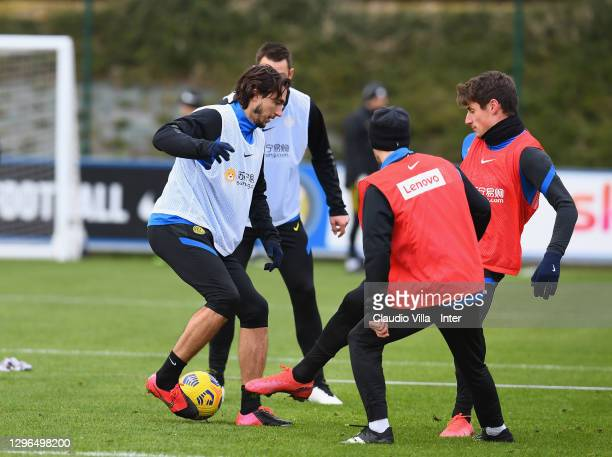 Matteo Darmian compete for the ball with Andrea Pinamonti during an FC Internazionale training session at Appiano Gentile on January 15, 2021 in...