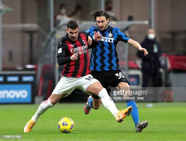Matteo Darmian competes for the ball with Theo Hernández of AC Milan during the Coppa Italia match between FC Internazionale and AC Milan at Stadio...
