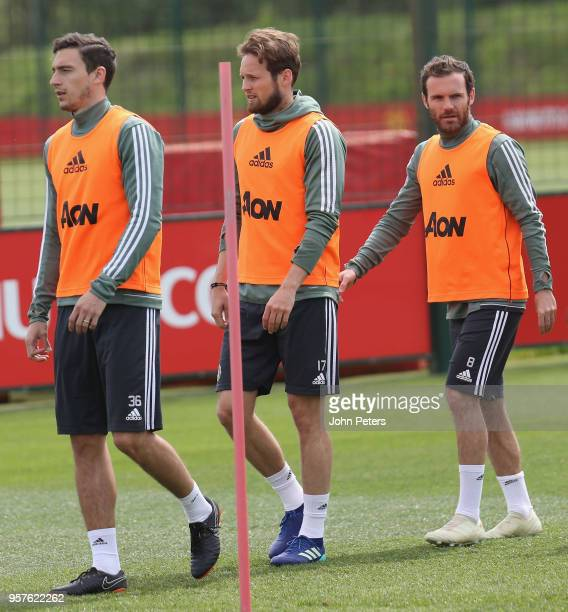 Matteo Darmian Daley Blind and Juan Mata of Manchester United in action during a first team training session at Aon Training Complex on May 12 2018...