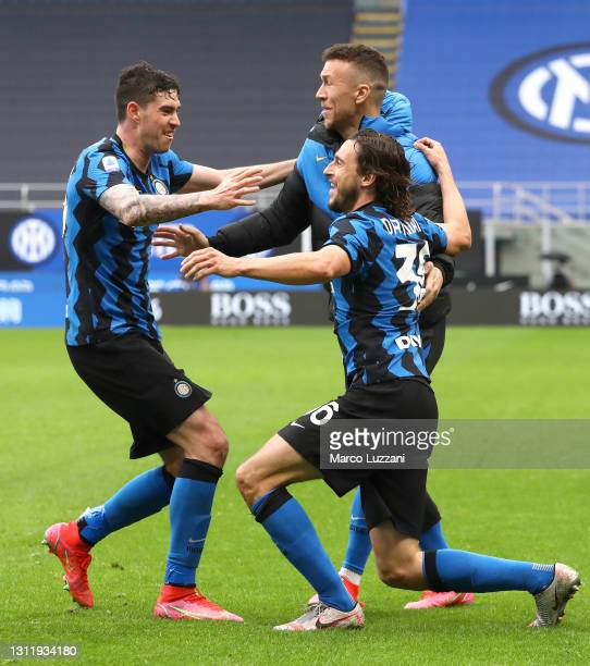 Matteo Darmian of FC Internazionale celebrates with Alessandro Bastoni after scoring their side's first goal during the Serie A match between FC...