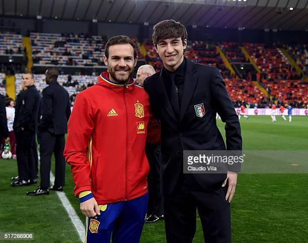 Matteo Darmian of Italy and Juan Mata of Spain chat prior to the international friendly match between Italy and Spain at Stadio Friuli on March 24...