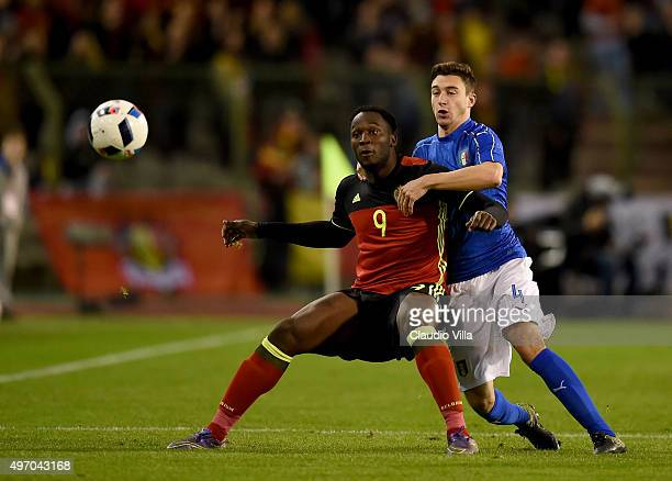 Matteo Darmian of Italy and Romelu Lukaku of Belgium compete for the ball during the intermational friendly match between Belgium and Italy at King...