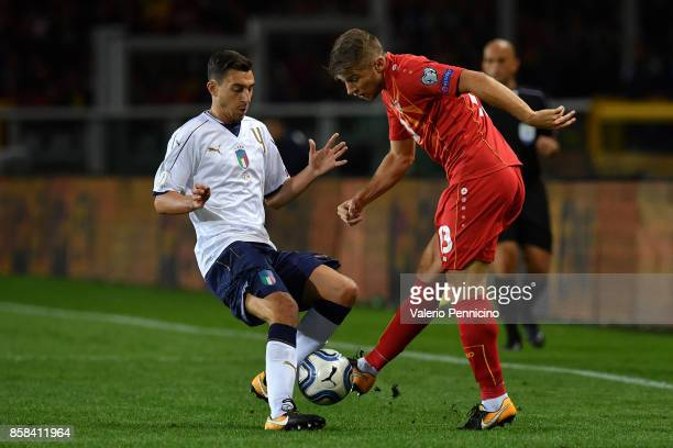 Matteo Darmian of Italy competes for the ball with Egzijan Alioski of FYR Macedonia during the FIFA 2018 World Cup Qualifier between Italy and FYR...