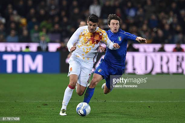 Matteo Darmian of Italy competes with Alvaro Morata of Spain during the international friendly match between Italy and Spain at Stadio Friuli on...