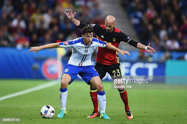 Matteo Darmian of Italy controls the ball under pressure of Laurent Ciman of Belgium during the UEFA EURO 2016 Group E match between Belgium and...