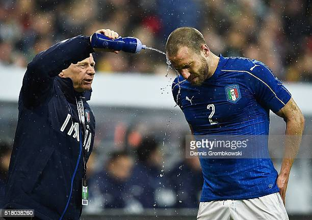 Matteo Darmian of Italy receives treatment after colliding with Jonas Hector of Germany during the International Friendly match between Germany and...