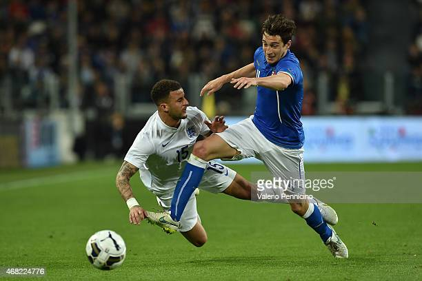 Matteo Darmian of Italy tackles Kyle Walker of England during the international friendly match between Italy and England at the Juventus Arena on...