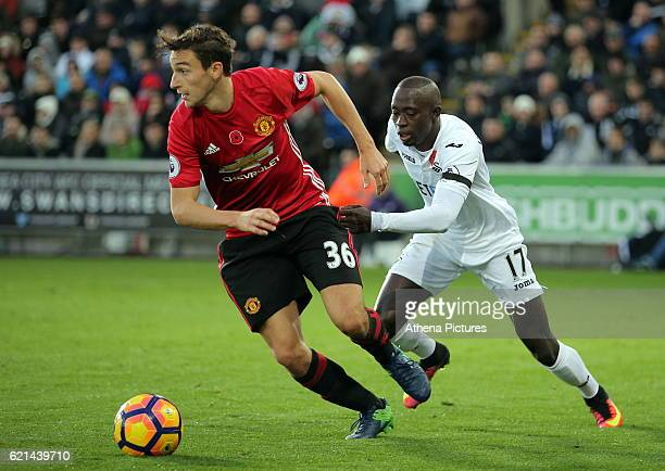 Matteo Darmian of Manchester City against Modou Barrow of Swansea City during the Premier League match between Swansea City and Manchester United at...
