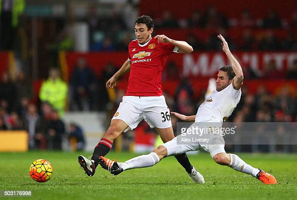 Matteo Darmian of Manchester United and Angel Rangel of Swansea City compete for the ball during the Barclays Premier League match between Manchester...