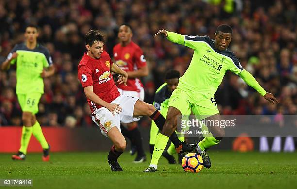 Matteo Darmian of Manchester United and Georginio Wijnaldum of Liverpool battle for the ball during the Premier League match between Manchester...