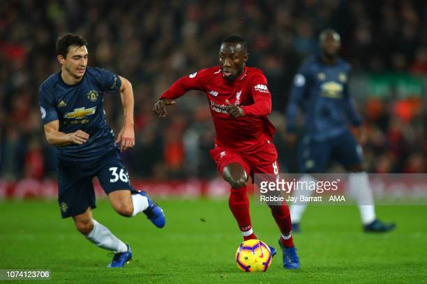 Matteo Darmian of Manchester United and Naby Keita of Liverpool during the Premier League match between Liverpool FC and Manchester United at Anfield...