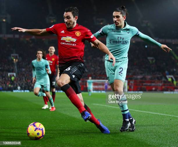 Matteo Darmian of Manchester United battles for possession with Hector Bellerin of Arsenal during the Premier League match between Manchester United...