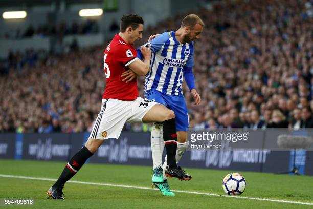 Matteo Darmian of Manchester United battles for the ball with Glenn Murray of Brighton Hove Albion during the Premier League match between Brighton...