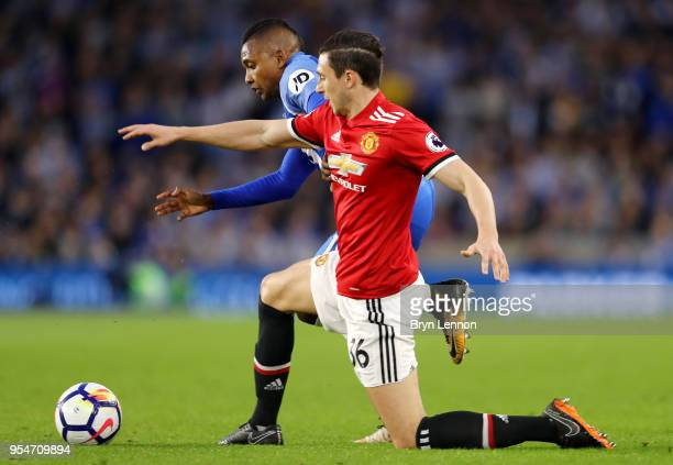 Matteo Darmian of Manchester United battles for the ball with Jose Izquierdo of Brighton Hove Albion during the Premier League match between Brighton...