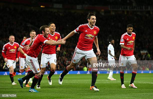 Matteo Darmian of Manchester United celebrates with team mates after scoring his sides second goal during the Barclays Premier League match between...