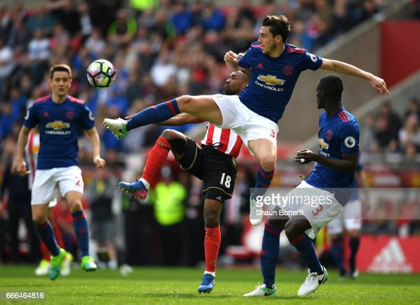 Matteo Darmian of Manchester United challenges for the ball with Jermain Defoe of Sunderland during the Premier League match between Sunderland and...